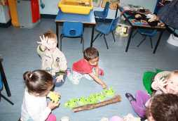 learning at poplars nursery school children playing games on the floor