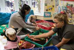 our experienced staff at poplars day nurseries, children playing with vegetables